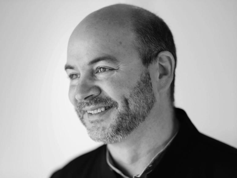 Black and white photo of Snøhetta co-founder Craig Dykers