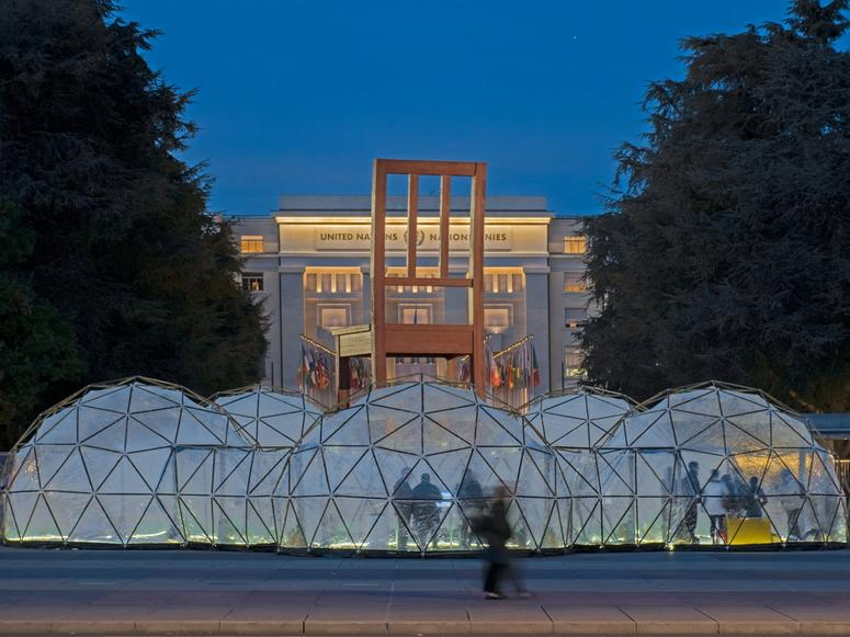 Michael Pinsky's Pollution Pod domes, with people inside and out.
