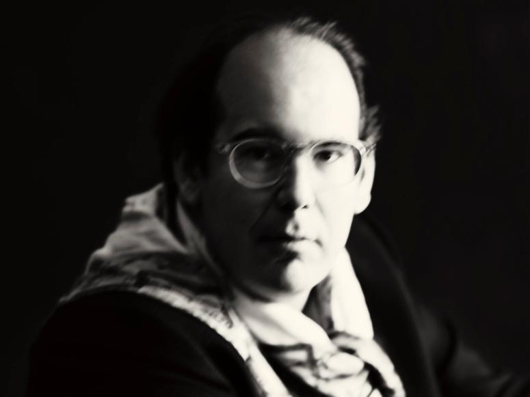 black and white photo of scholar and critic Donatien Grau