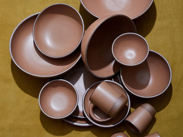 Brown bowls on a dark yellow background.