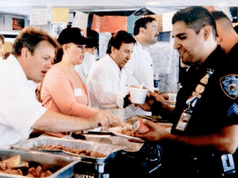 Daniel Boulud and other chefs serve food to first responders after the attacks in September 2001