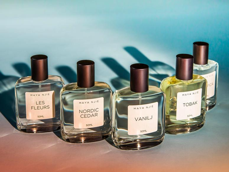 Five bottles of perfume on an ombre table