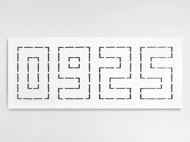 """A white wall piece reading """"0925"""" in dotted lines."""