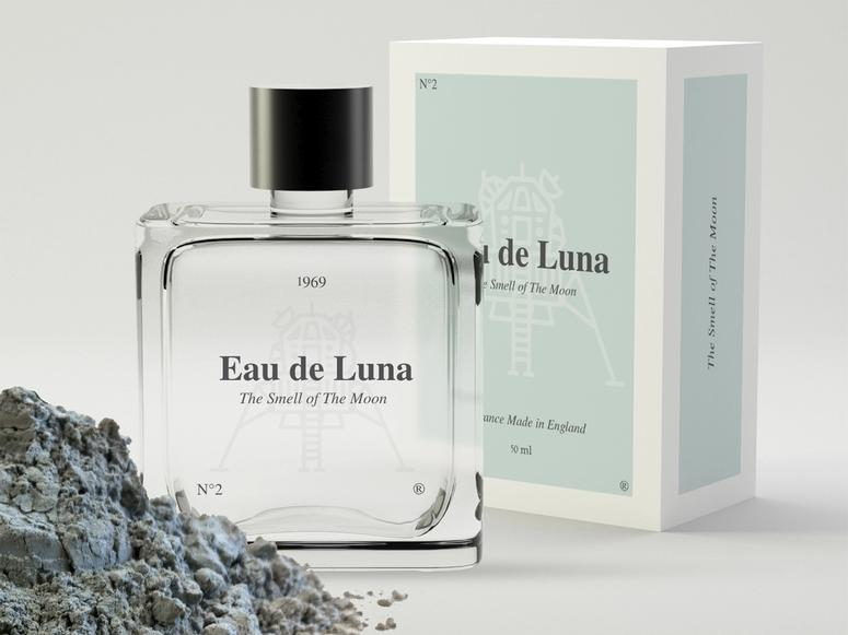 NASA's Eau de Luna perfume next to a pile of moon rocks.