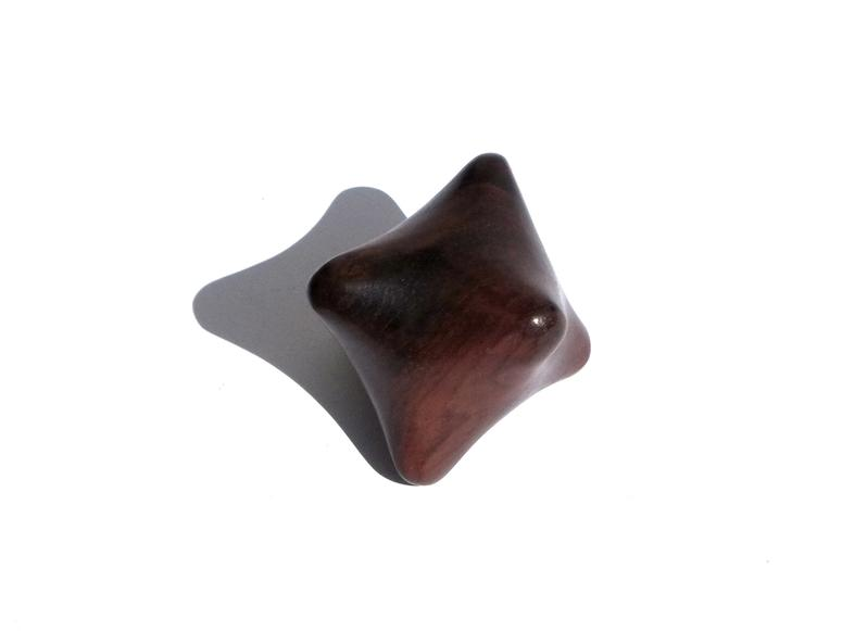 A wooden polygonal massage tool.