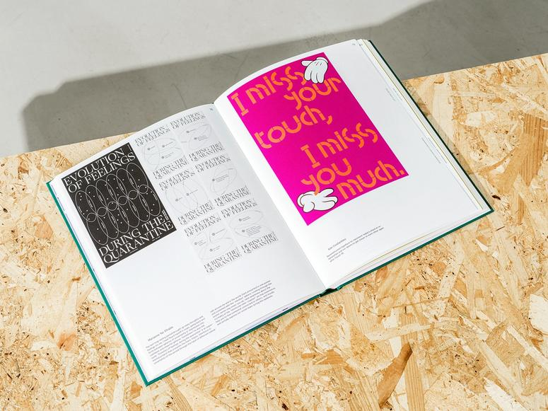 """The book """"Designers Against Coronavirus"""" open on a wood table"""