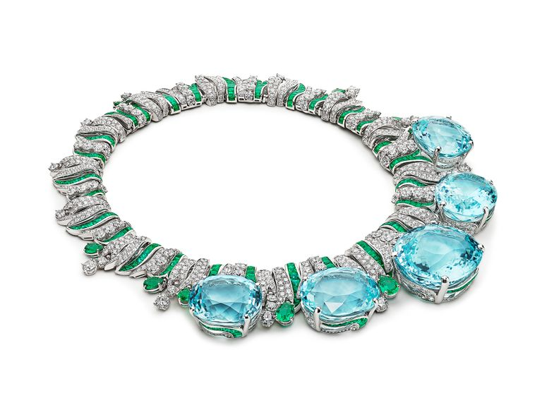 A diamond necklace with large turquoise gems