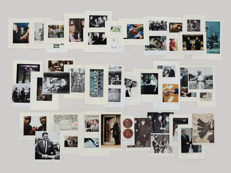 """A photograph of images from the Picture Collection's Handshaking folder by Taryn Simon, featured in the exhibition """"The Color of a Flea's Eye."""""""
