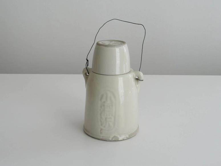 A white ceramic kettle on a white background.