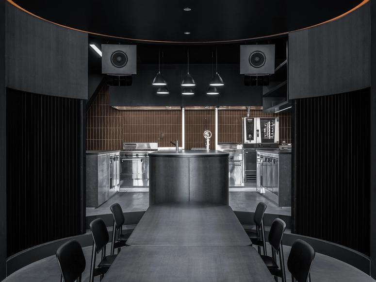 The dark interior of Burnside Tokyo, facing the kitchen.