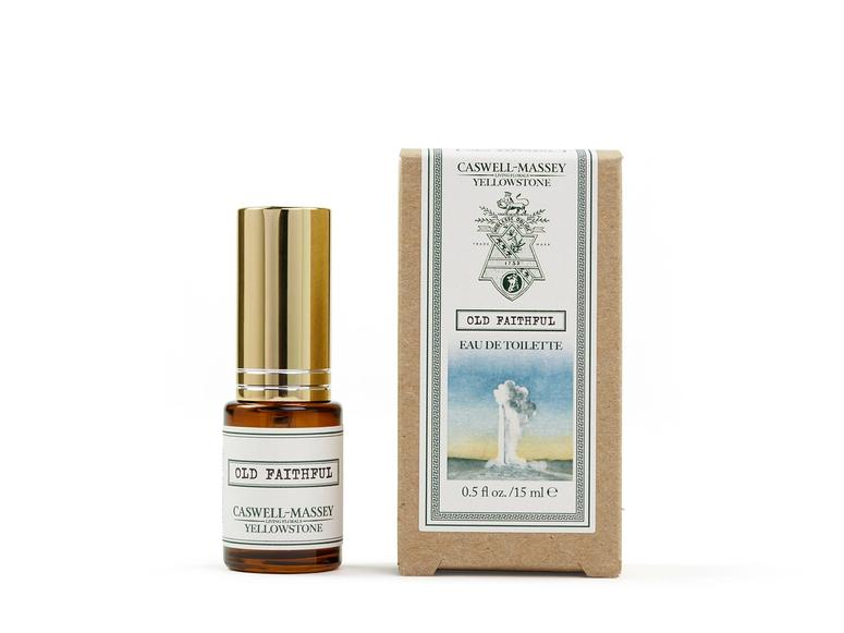 """A brown and gold bottle of perfume next to a box reading """"Old Faithful."""""""