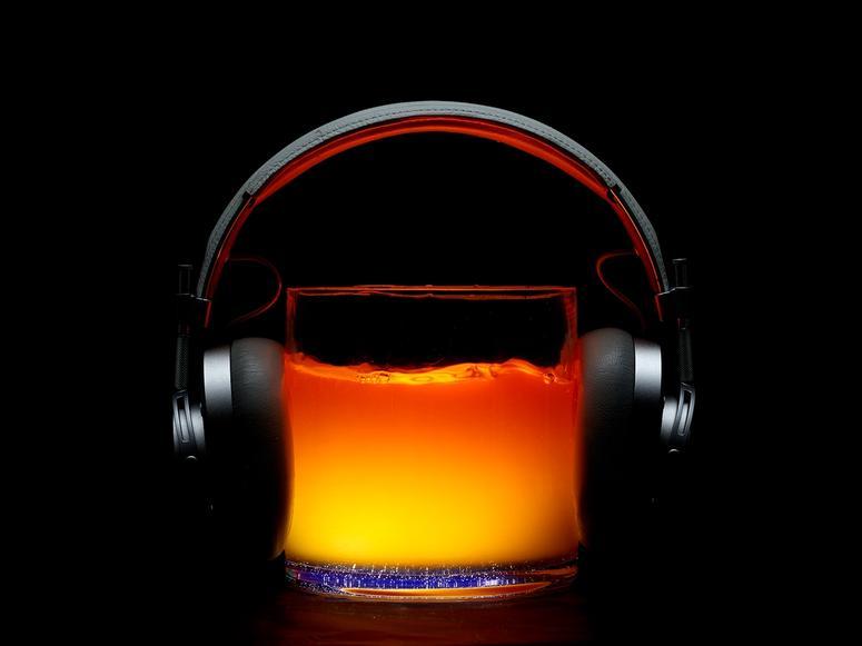 Headphones on a glass of liquid.