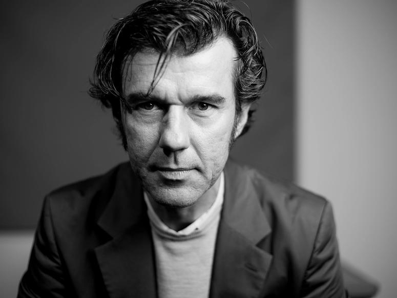 Stefan Sagmeister looking straight into the camera.