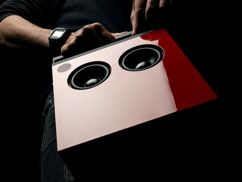 A red OB-4 boombox photographed from below.