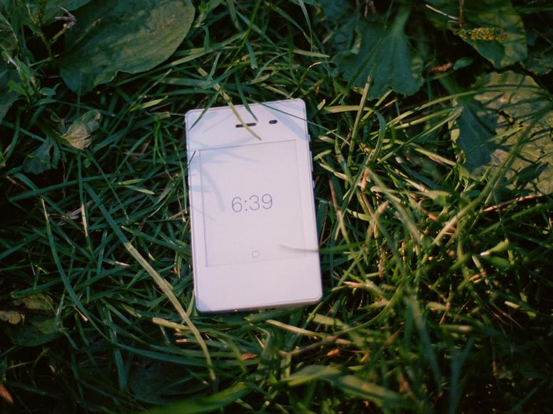 A white Light Phone in grass.