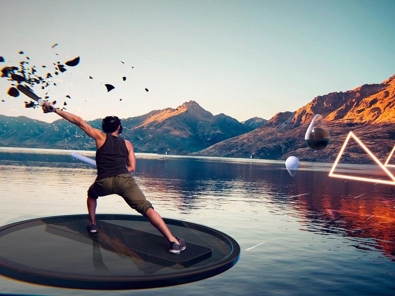 A man in virtual reality playing an exercise game, floating on a disk above a lake.