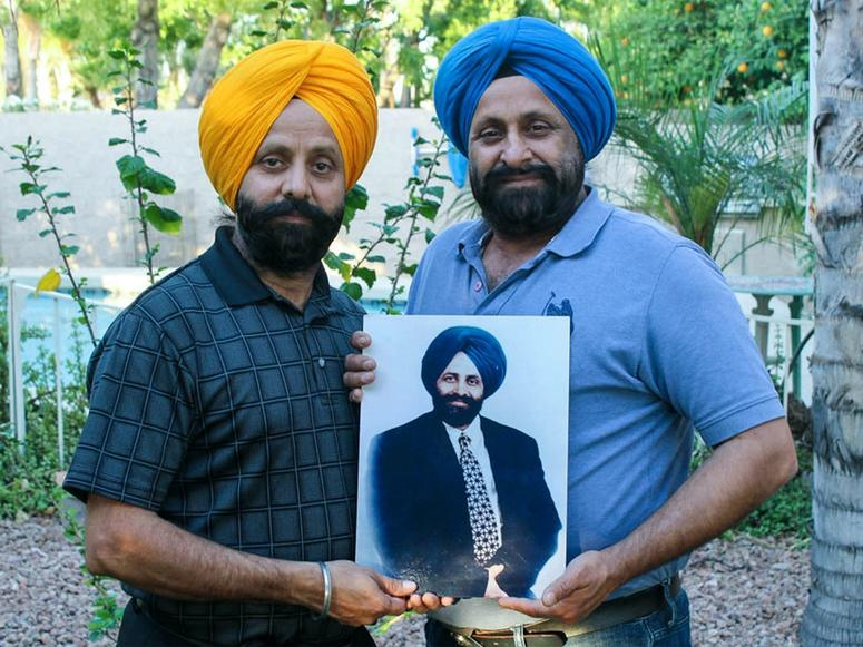 Rana and Harjit Sodhi holding a photo of their late brother, Balbir Singh Sodi, who died on 9/11