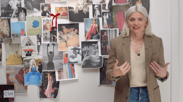 Stylist Kate Young stands in front of a mood board