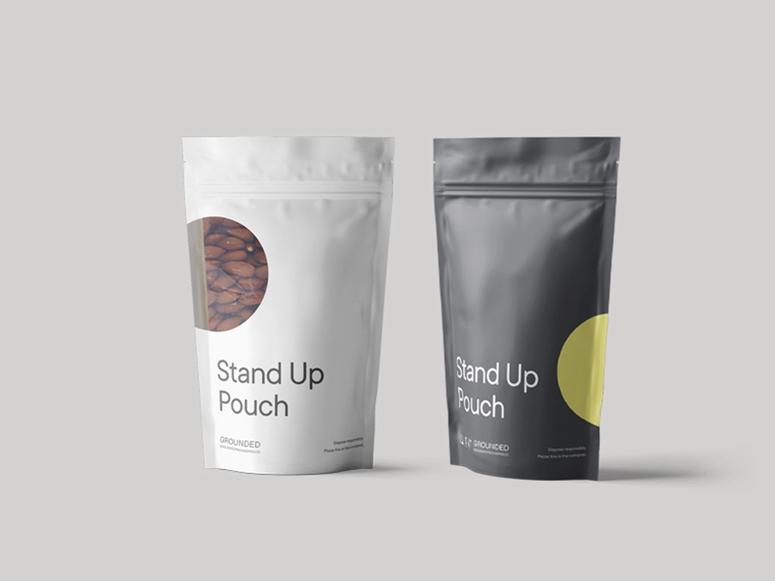 """Two Grounded Packaging """"stand up pouches"""" in black and white."""