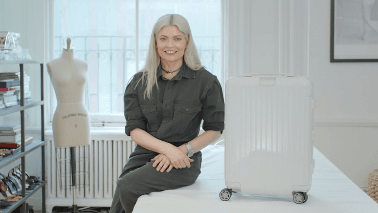 Stylist Kate Young with a white suitcase