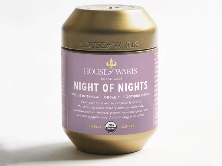 A purple and gold canister of House of Waris Night of Nights tea.