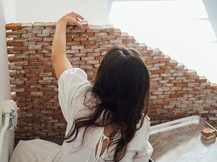 María Elena Pombo stacking bricks for an exhibition.