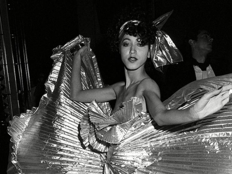 A photo of a dancer in a glittering dress, from inside Studio 54.