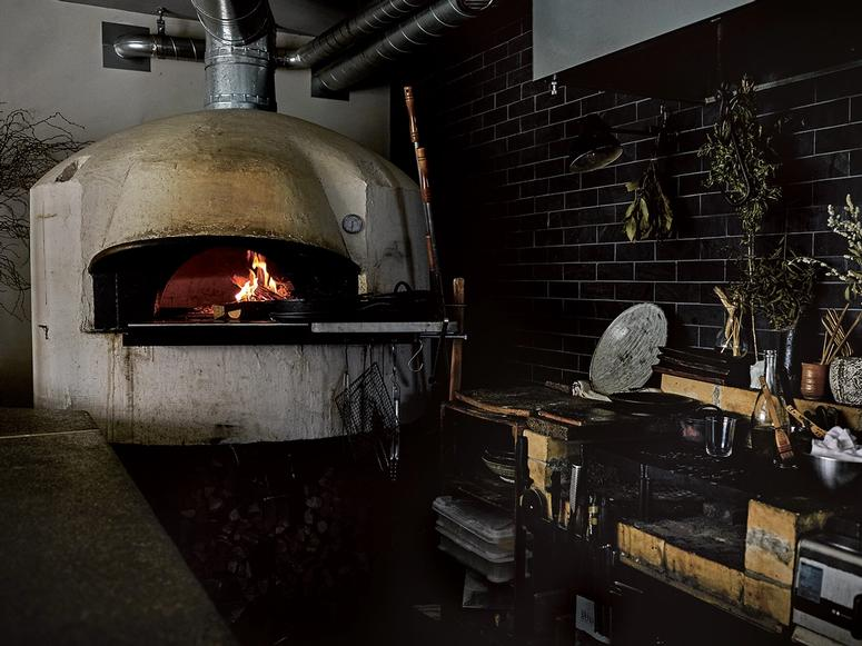 A wood-fired oven in a kitchen.