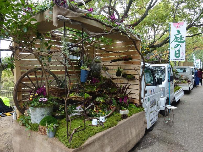 A small truck with a garden built inside the truck bed