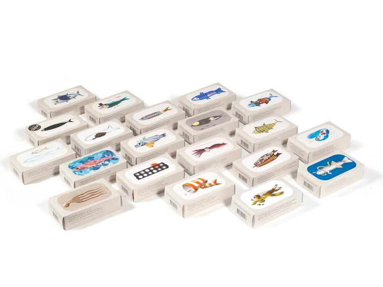 The José Gourmet conservas line of brightly colored boxes on a white surface.