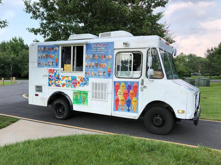 A classic ice cream truck in the summer.