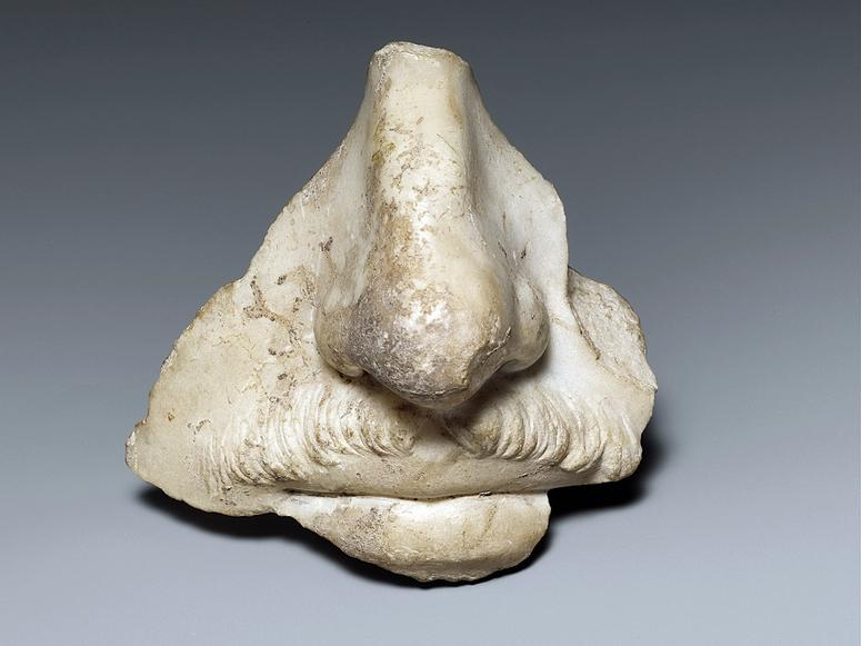 The nose fragment of a stone sculpture.