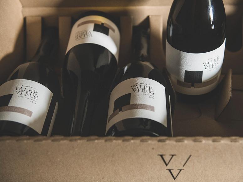 Four Valke Vleug wine bottles in a carton.