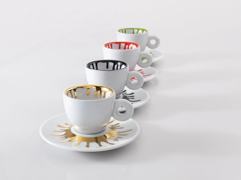 Four espresso cups and saucers with a paint splatter motif