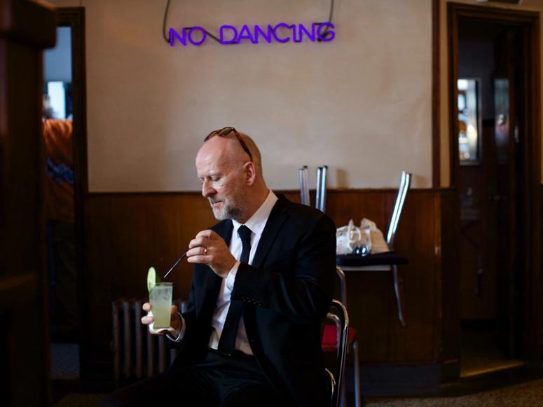 Philosopher Simon Critchley having a drink at a bar