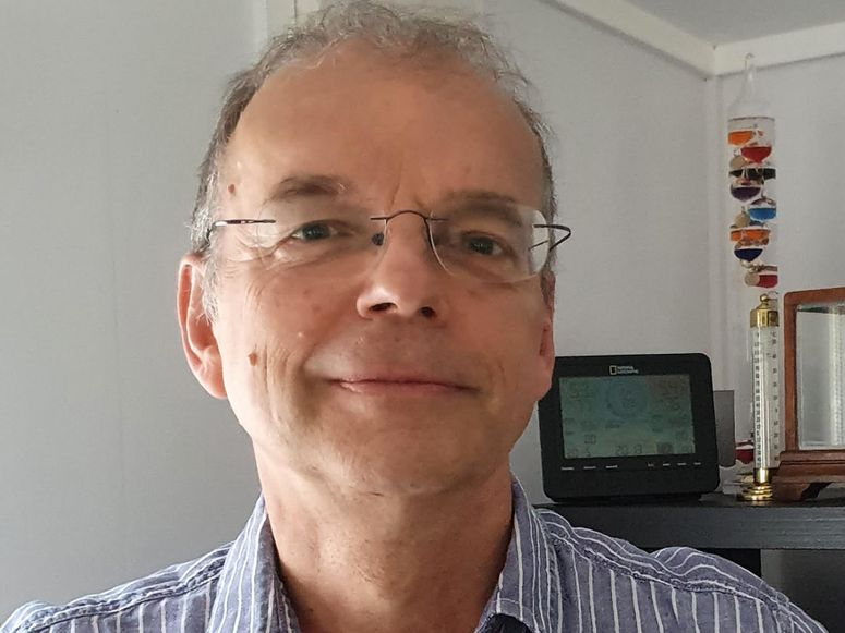 A man wearing glasses and a striped shirt