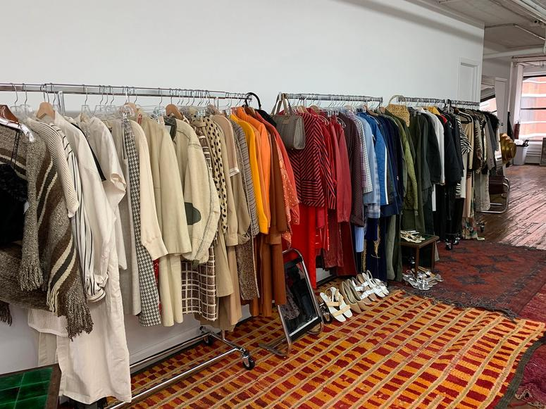 The interior of Object Limited, with racks of clothes along a wall.