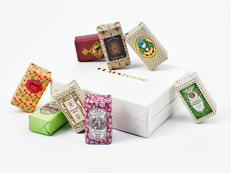 An assortment of colorful Claus Porto soaps on their white box.