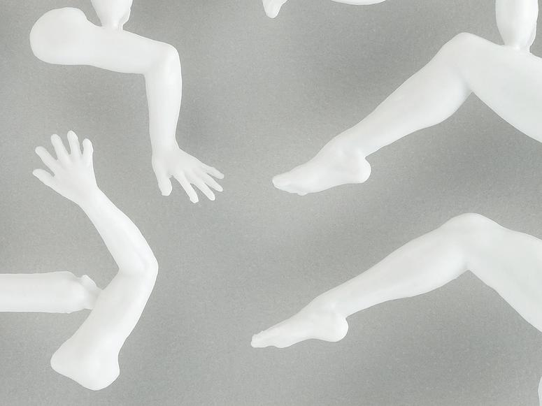 Disembodied plastic limbs on a grey background.