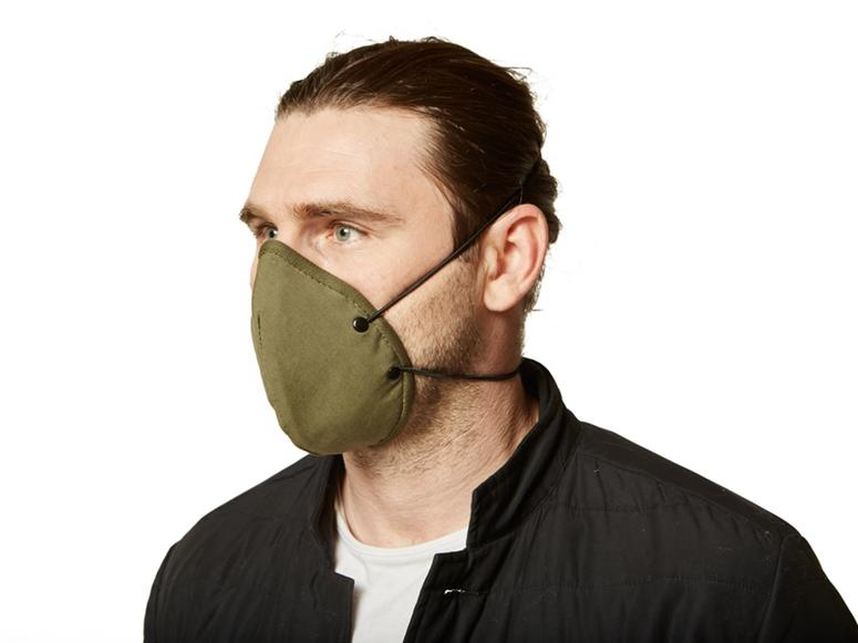 A man wearing an army green face mask.