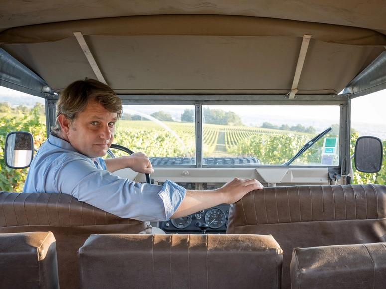 Aymeric de Gironde in an old truck on the vineyard.
