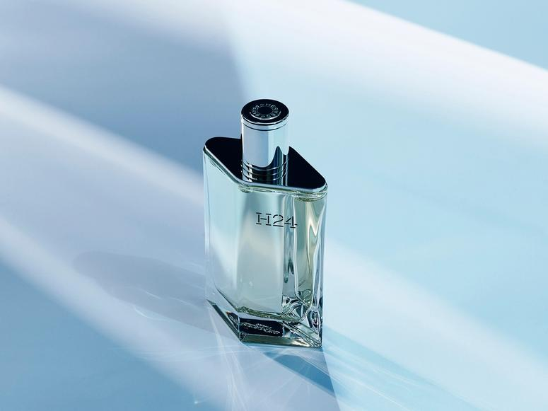 A bottle of Hermés's H24 in futuristic lighting.