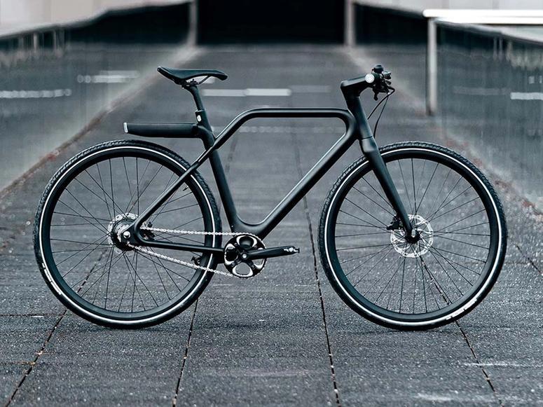 A black Angell bike on concrete in profile.