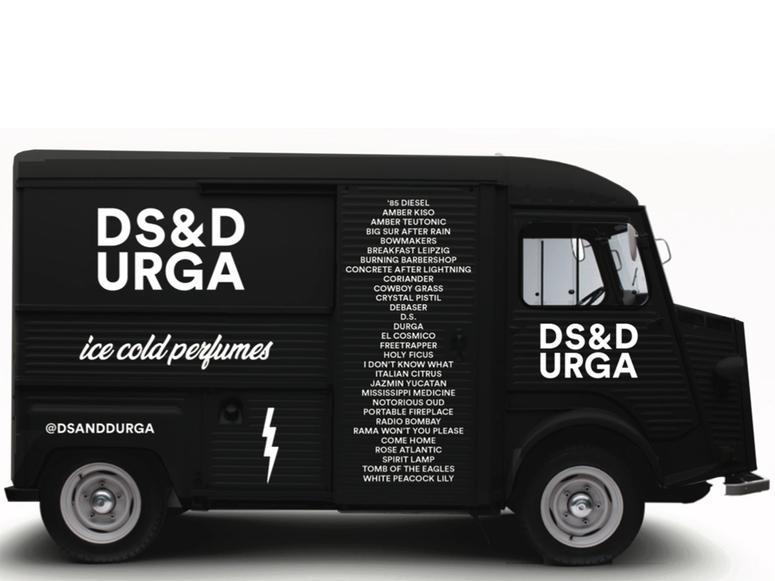 The black D.S. & Durga perfume truck.