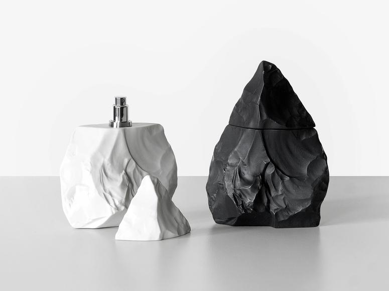 Neanderthal perfume in black and white cases.