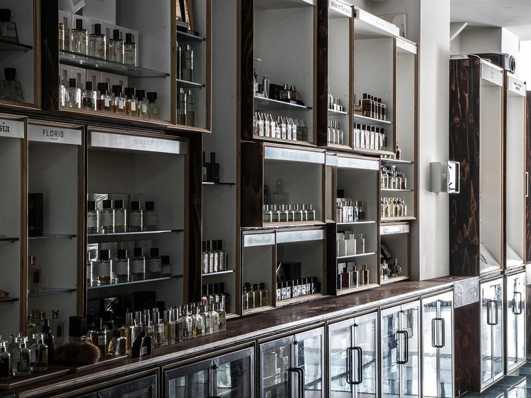 The interior of a fragrance boutique, with many bottles lined up on shelves.