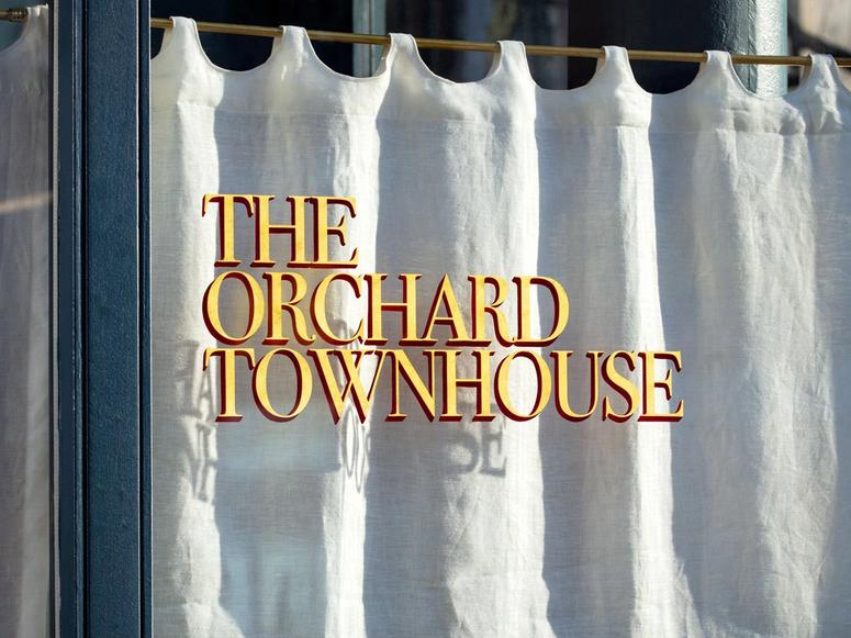 A window with lettering at The Orchard Townhouse.
