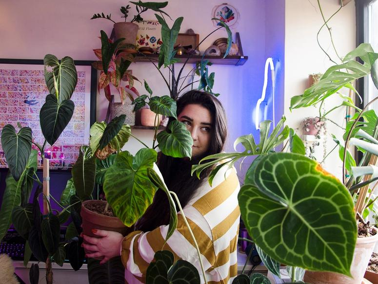 Alessia Resta in her plant-and-neon-filled apartment.