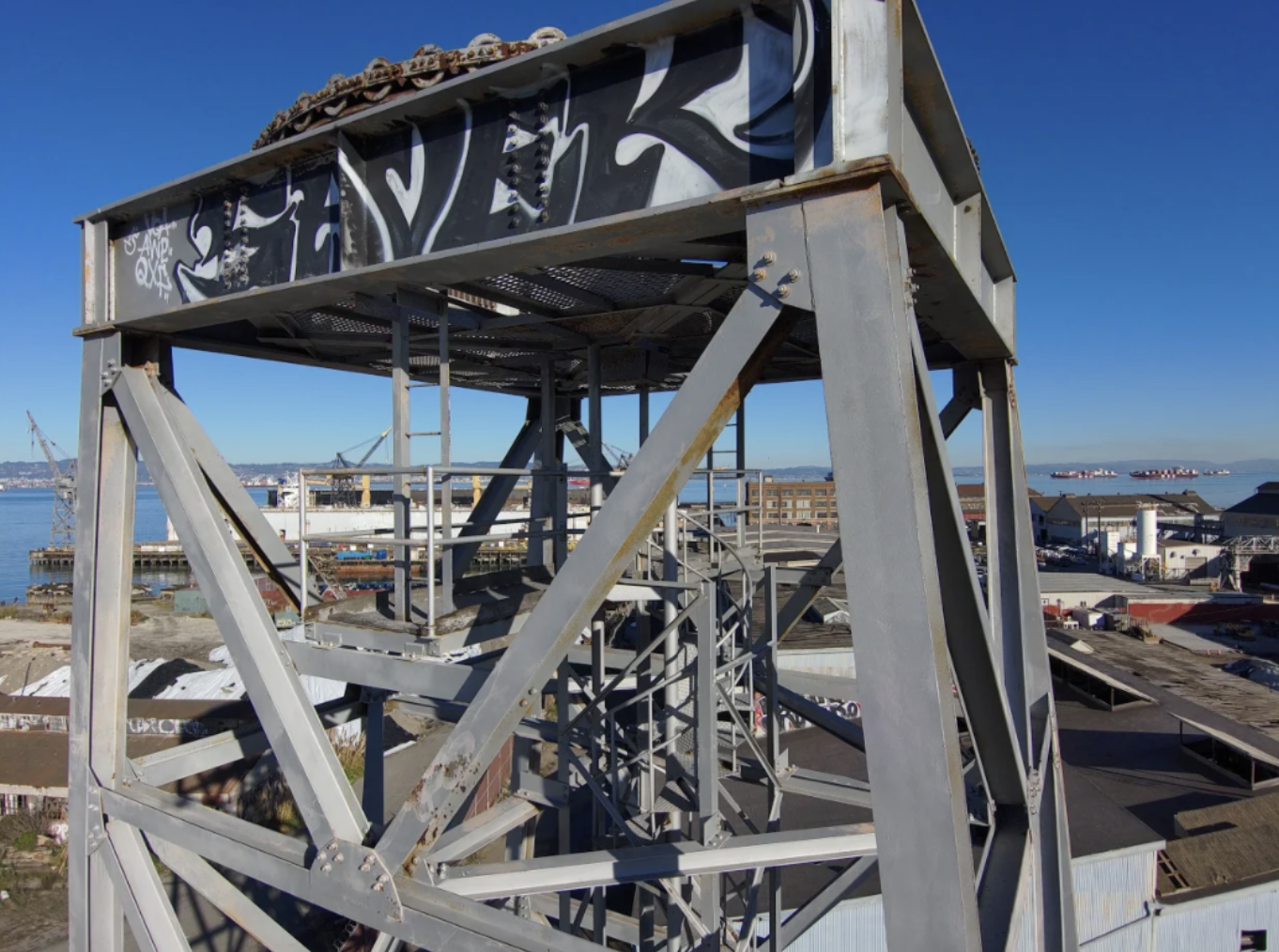 A construction site crane mast needs to be inspected for rust and other damage.