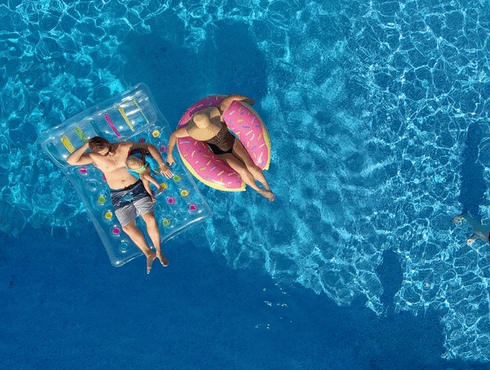 Family in pool from above